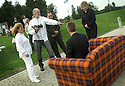 05/08/2004   Copyright Pic: James Stewart.File Name : jspa05_yerbury.PHOTOGRAPHER TREVOR YERBURY EMBARKS ON HIS SCOTLAND'S PEOPLE EXHIBITION AT THE FALKIRK WHEEL WITH HIS TARTAN SOFA AND THE HELP OF THE CANDIDATES FOR THE SNP LEADERSHIP, MIKE RUSSELL, ROSESANA CUNNINGHAM AND ALEX SALMOND......Payments to :.James Stewart Photo Agency 19 Carronlea Drive, Falkirk. FK2 8DN      Vat Reg No. 607 6932 25.Office     : +44 (0)1324 570906     .Mobile  : +44 (0)7721 416997.Fax         :  +44 (0)1324 570906.E-mail  :  jim@jspa.co.uk.If you require further information then contact Jim Stewart on any of the numbers above.........