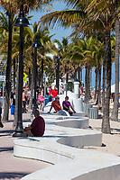Ft. Lauderdale, Florida.  Sculpted White Wave Between Sidewalk and Beach along Atlantic Boulevard.