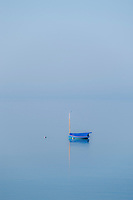 Small sailboat on misty water, Truro, Cape Cod, MA