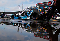 Sep 1, 2019; Clermont, IN, USA; The car of NHRA funny car driver Shawn Langdon reflects in a rain puddle during qualifying for the US Nationals at Lucas Oil Raceway. Mandatory Credit: Mark J. Rebilas-USA TODAY Sports