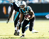 CHARLOTTE, NC - NOVEMBER 3: D.J. Moore #12 of the Carolina Panthers runs with the ball after a reception during a game between Tennessee Titans and Carolina Panthers at Bank of America Stadium on November 3, 2019 in Charlotte, North Carolina.