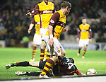 Motherwell v St Johnstone.....01.01.14   SPFL<br /> Gwion Edwards is brought down by Stevie Hammell in the box but the ref awarded a free kick outside the box<br /> Picture by Graeme Hart.<br /> Copyright Perthshire Picture Agency<br /> Tel: 01738 623350  Mobile: 07990 594431