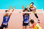 #21 Ai Kurogo of Japan (C) blocks #6 Xiangyu Gong of China (R) during the match between China and Japan on May 30, 2018 in Hong Kong, Hong Kong. (Photo by Power Sport Images/Getty Images)