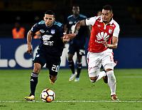 BOGOTA - COLOMBIA - 01 - 03 - 2018: Yeison Gordillo (Der.) jugador de Independiente Santa Fe disputa el balón con Robert Burbano (Izq.) jugador de Emelec (ECU), durante partido entre Independiente Santa Fe (COL) y Emelec (ECU), de la fase de grupos, grupo 4, fecha 1 de la Copa Conmebol Libertadores 2018, jugado en el estadio Nemesio Camacho El Campin de la ciudad de Bogota. / Yeison Gordillo (R) player of Independiente Santa Fe vies for the ball with Robert Burbano (L) player of Emelec (ECU), during a match between Independiente Santa Fe (COL) and Emelec (ECU), of the group stage, group 4, 1st date for the Conmebol Copa Libertadores 2018 at the Nemesio Camacho El Campin Stadium in Bogota city. Photo: VizzorImage  / Luis Ramirez / Staff.