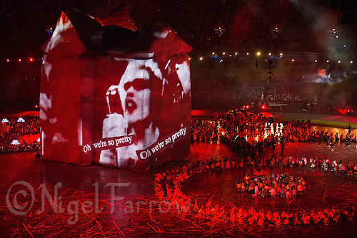 """27 JUL 2012 - LONDON, GBR - A Sex Pistol music video is projected on a giant house during the """"Frankie and June say...thanks Tim"""" section of the Opening Ceremony of the London 2012 Olympic Games in the Olympic Stadium in the Olympic Park, Stratford, London, Great Britain (PHOTO (C) 2012 NIGEL FARROW)"""