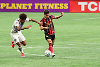 ATLANTA, GA - AUGUST 29: Matheus Rossetto #9 of Atlanta United dribbles the ball while defended by Junior Urso #11 of Orlando City during a game between Orlando City SC and Atlanta United FC at Marecedes-Benz Stadium on August 29, 2020 in Atlanta, Georgia.