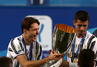 Football: Super Cup Final Juventus vs Napoli at Mapei Stadium in Reggio Emilia, on January 20,  2021.<br /> Juventus' Federico Chiesa (l) and Alvaro Morata (r) celebrate with the trophy after winning 2-0  the Italian Super Cup Final match between Juventus and Napoli at Mapei Stadium in Reggio Emilia, on January 20,  2021.<br /> UPDATE IMAGES PRESS/Isabella Bonotto