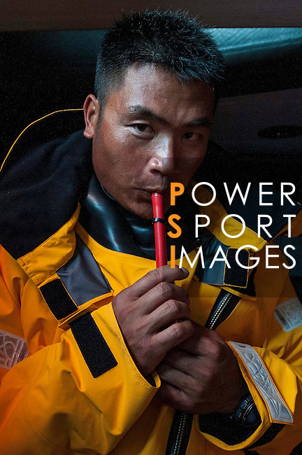 Sailors and shore crew prepare Dongfeng VOR65 for training and delivery to Auckland on Hainan waters ahead the 2014/15 Volvo Ocean Race on March 19 2014 in Sanya, China. Photo by Xaume Olleros / Power Sport Images