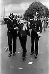 Scottish football fan being led away by the police for being drunk. Wembley Football Stadium, London  1981.