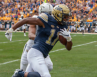Pitt wide receiver Taysir Mack (11) makes a 60-yard reception and run before being pushed out of bounds by Georgia Tech defensive back Lamont Simmons (6). The Pitt Panthers football team defeated the Georgia Tech Yellow Jackets 24-19 on September 15, 2018 at Heinz Field in Pittsburgh, Pennsylvania.