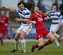 Raith's Jason Thomson is caught late by Morton's Mark McLaughlin.