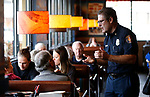 Carson City Fire Chief Sean Slaman talks with guests as first responders from around the area wait on diners at Bodines and SlotWorld as part of the Feast with a Hero fundraiser in Carson City, Nev., on Saturday, Dec. 15, 2018. <br /> Photo by Cathleen Allison/Nevada Momentum