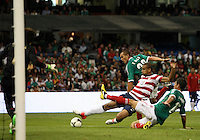 MEXICO CITY, MEXICO - AUGUST 15, 2012:  Terrence Boyd (18) of the USA MNT shoots as Hector Moreno (15) and Jorge Torres Nilo (20) of  Mexico move in during an international friendly match at Azteca Stadium, in Mexico City, Mexico on August 15. USA won 1-0.