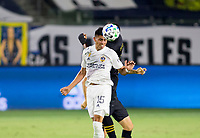 CARSON, CA - SEPTEMBER 06: Joe Corona #15  of Los Angeles Galaxy heads a ball a ball past Eddie Segura #4 of LAFC during a game between Los Angeles FC and Los Angeles Galaxy at Dignity Health Sports Park on September 06, 2020 in Carson, California.