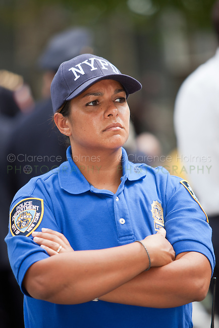 A NYPD officer provides security at the West Indian American Day Parade held on Monday, September 5, 2011 in Crown Heights, Brooklyn, New York.