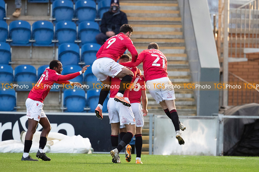Morecambe celebrate the opening goal scored by John O'Sullivan of Morecambe during Colchester United vs Morecambe, Sky Bet EFL League 2 Football at the JobServe Community Stadium on 19th December 2020