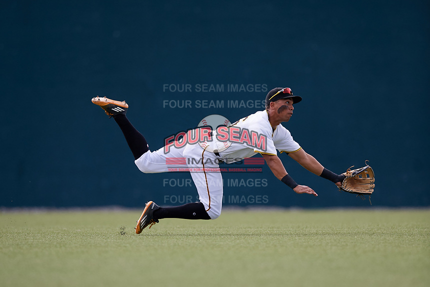 GCL Pirates left fielder John Lantigua (26) dives for a ball during the first game of a doubleheader against the GCL Yankees East on July 31, 2018 at Pirate City Complex in Bradenton, Florida.  GCL Yankees East defeated GCL Pirates 2-0.  (Mike Janes/Four Seam Images)