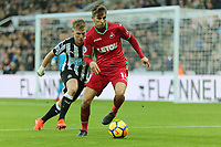 Tom Carroll of Swansea City (R) chased by Matt Ritchie of Newcastle during the Premier League match between Newcastle United and Swansea City at St James' Park, Newcastle, England, UK. Saturday 13 January 2018