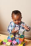17 month old toddler bloy stacking blocks