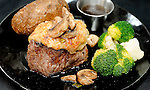 A Parmesan garlic filet mignon, finished with exotic mushrooms, is plated.  (DOUG WOJCIK/STEVENS POINT JOURNAL)
