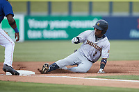 Abiezel Ramirez (2) of the Charleston RiverDogs slides into third base during the game against the Kannapolis Cannon Ballers at Atrium Health Ballpark on July 1, 2021 in Kannapolis, North Carolina. (Brian Westerholt/Four Seam Images)
