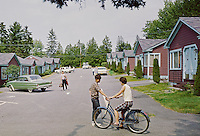 Marian Village, Camden, Maine.  Girl on bike talking to a young boy 1962