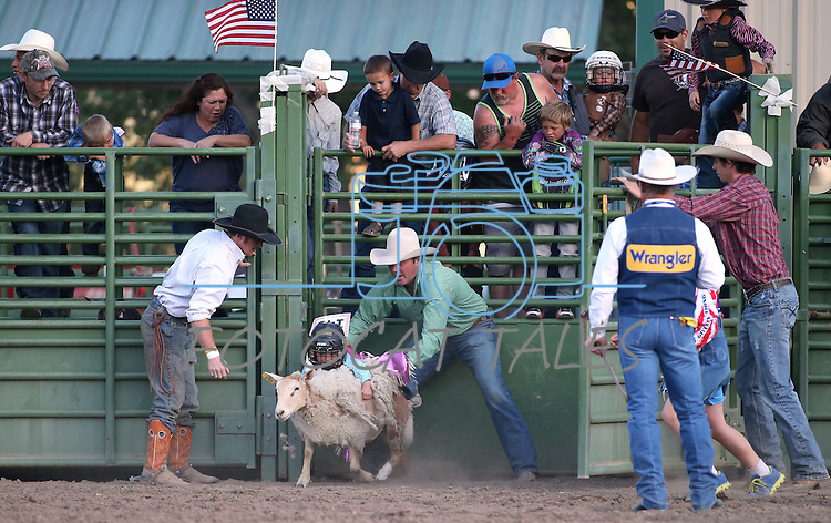 Payslee Starr, of Fallon, competes in the Mutton Bustin' portion of the Smackdown Tour Bull Riding event at Fuji Park in Carson City, Nev., on Saturday, June 7, 2014.<br /> Photo by Cathleen Allison