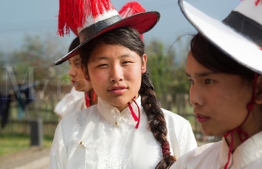 Kathmandu Nepal Nepali girls stand waiting to practice a ceremonial dance in traditional Himalayan costumes in Nayapati Eastern Kathmandu   1