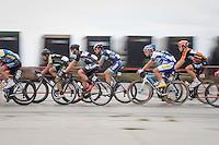 peloton speeding along<br /> <br /> 101st Kampioenschap van Vlaanderen 2016 (UCI 1.1)<br /> Koolskamp › Koolskamp (192.4km)