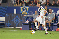 CARSON, CA - SEPTEMBER 15: Daniel Steres #5 of the Los Angeles Galaxy looks for an open man during a game between Sporting Kansas City and Los Angeles Galaxy at Dignity Health Sports Complex on September 15, 2019 in Carson, California.