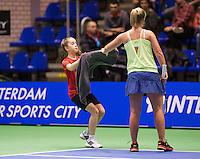 December 21, 2014, Rotterdam, Topsport Centrum, Lotto NK Tennis, Richel Hogenkamp gets a zowel from a ballgirl<br /> Photo: Tennisimages/Henk Koster