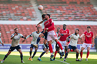 9th January 2021; City Ground, Nottinghamshire, Midlands, England; English FA Cup Football, Nottingham Forest versus Cardiff City; Miguel Angel Guerrero of Nottingham Forest climbs in front of Will Vaults of Cardiff City to head the ball from a corner kick