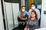 Valarie Ashe gets vaccinated by Veronka Machova and Pharmacist William Sheahan in Killarney on Monday