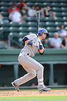 Second baseman Forrest Wall (7) of the Asheville Tourists bats in a game against the Greenville Drive on Friday, April 24, 2015, at Fluor Field at the West End in Greenville, South Carolina. Wall was a first-round pick of the Colorado Rockies in the 2014 First-Year Player Draft. Greenville won, 5-2. (Tom Priddy/Four Seam Images)