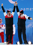 Sochi, Russia, 14/03/2014. Canadian skier Chris Williamson and guide Nick Brush celebrate their Bronze medal win in the mens's slalom visually impared at the Sochi 2014 Paralympic Winter Games in Sochi Russia. Photo(Scott Grant/Canadian Paralympic Committee)