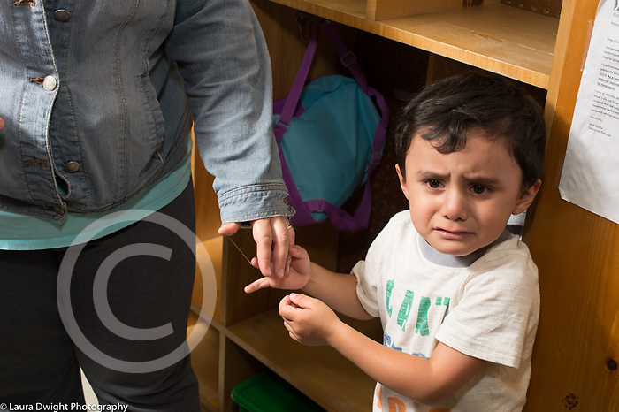 Preschool First Days of School sad boy with mother start of day separation