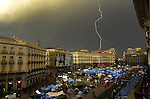 "A lightning falls on Madrid close to Puerta del Sol square on June 5, 2011 during a protest to decry mainstream political parties, soaring unemployment, corruption and welfare cuts. The leading protest group known as ""the indignants"" met today to decide whether to carry on their camp-out against political corruption and joblessness. (c) PEDRO ARMESTRE"