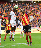 20191102 – Lens , France : Guillaume Gillet (27) of Lens pictured in a duel with Yoane Wissa (19) of Lorient during a French Ligue 2 soccer game between Racing Club de Lens and FC Lorient , a football game on the 13th matchday in the French second league, on saturday 2 nd of November 2019 at the Stade Bollaert Delelis in Lens , France . PHOTO SPORTPIX.BE | DAVID CATRY