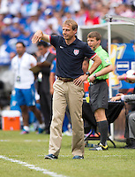 United States head coach Juergen Klinsmann tells the referee a could was a dive during the quarterfinals of the CONCACAF Gold Cup at M&T Bank Stadium in Baltimore, MD.  The United States defeated El Salvador, 5-1.