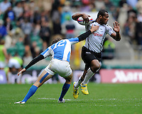 Watisoni Votu of Fiji goes past Franco Sabato of Argentina looks on during the iRB Marriott London Sevens at Twickenham on Saturday 11th May 2013 (Photo by Rob Munro)
