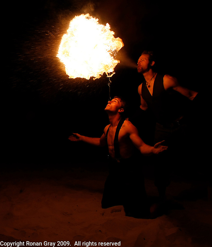 Friday, May 22 2009, San Diego, CA, USA:  Jonathan Nowaczyk (L) and Keane Carlson put on a fireshow for beach goers on the sand near Pacific Beach Drive at the start of the Memorial Day Weekend.