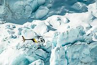 Helicopter is dwarfed by size of massive blocks of ice of Main Icefall on Franz Josef Glacier, Westland National Park, West Coast, UNESCO World Heritage, New Zealand, NZ