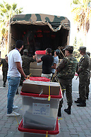 TUNIS, ARIANA - OCTOBER 05: Tunisian army soldiers distribute ballot boxes and election materials to a polling station in ARIANA, Tunisia on October 05, 2019. Tunisia will hold parliamentary elections on 06 October.