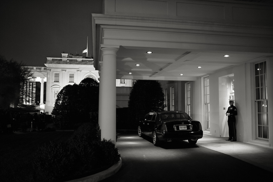 A United States Marine stands guard at the diplomatic entrance of the West Wing, near German Chancellor Angela Merkel's limousine.    Merkel was meeting with President Bush in the Oval Office at the White House in Washington Thursday, Jan. 4, 2007.<br /> Photo by Brooks Kraft/Corbis