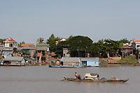 Mekong River<br /> , Cambodia - 2007 File Photo -<br /> <br /> <br /> fishing village huts, long boat.    <br /> <br /> <br /> <br /> photo : James Wong-  Images Distribution