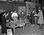 Pittsburgh PA:  View of a Civil Service exhibit at the William Penn Hotel during World War II. for the The exhibit created awareness and solicited help for the Ground Observer Corps.  Due to Pittsburgh's great importance to the war effort, the Ground Corps were chartered with keeping a close eye on the sky's above Pittsburgh in case of an enemy attack.  Sarah Stewart was on booth duty to help recruit more people to the Ground Observer Corps.