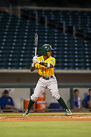 AZL Athletics second baseman Marcos Brito (13) bats during a game against the AZL Cubs on August 9, 2017 at Sloan Park in Mesa, Arizona. AZL Athletics defeated the AZL Cubs 7-2. (Zachary Lucy/Four Seam Images)