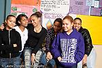 High school group of female students posing in corridor during lunch break