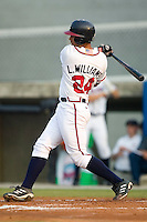 Danville Braves outfielder Larry Williams follows through on his swing versus the Greeneville Astros at American Legion Field in Danville, VA, Saturday, July 1, 2006.