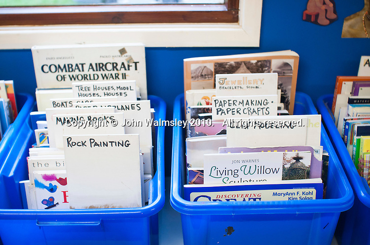 Boxes of books, Summerhill School, Leiston, Suffolk. The school was founded by A.S.Neill in 1921 and is run on democratic lines with each person, adult or child, having an equal say.  You don't have to go to lessons if you don't want to but could play all day.  It gets above average GCSE exam results.